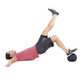 Single leg hip raises met medicine ball